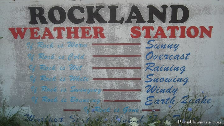 The weather station tells you how to interpret the hanging rock.