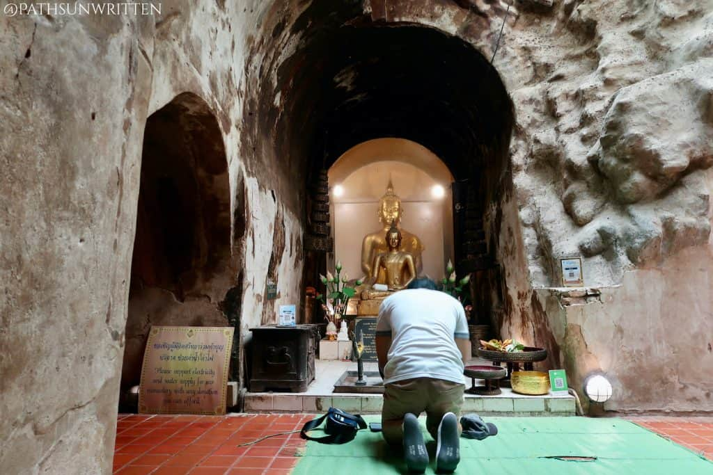 Praying at the tunnel's wiharn.
