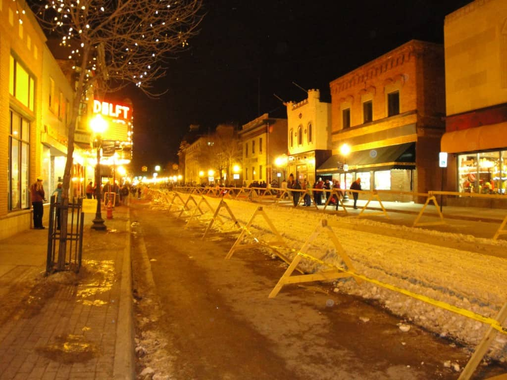 The main street of Marquette, Michigan barricaded for snowmobiles during the winter.