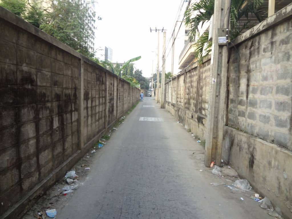 A truly featureless alley leading to the main street.