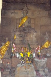 The meditating Buddha or monk inside the prang.
