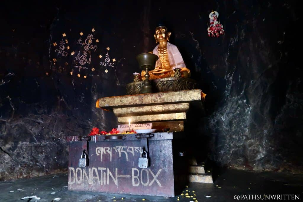 The golden ascetic Siddhartha Gautama statue inside the main cave