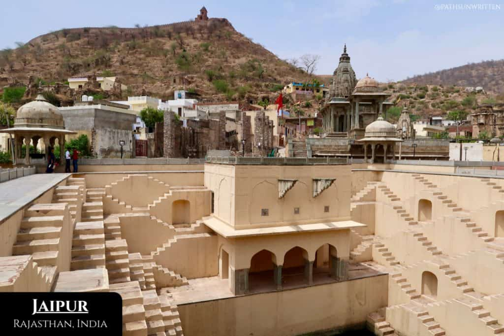 The Panna Meena ka Kund Stepwell with fortress walls outside of Jaipur.