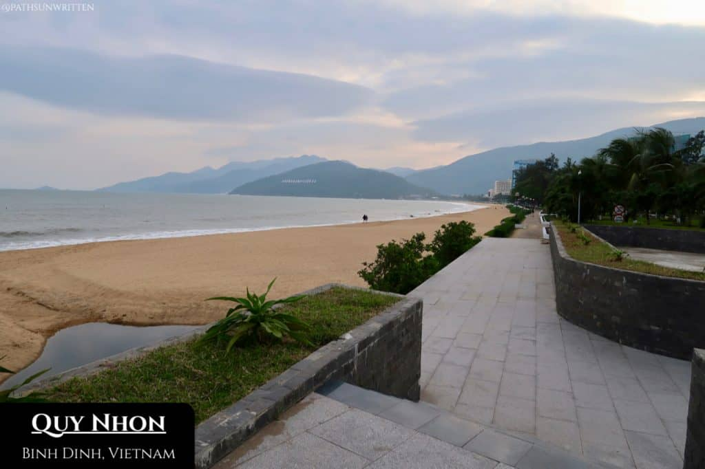 Quy Nhon's beachfront sheltered on all sides by mountains.