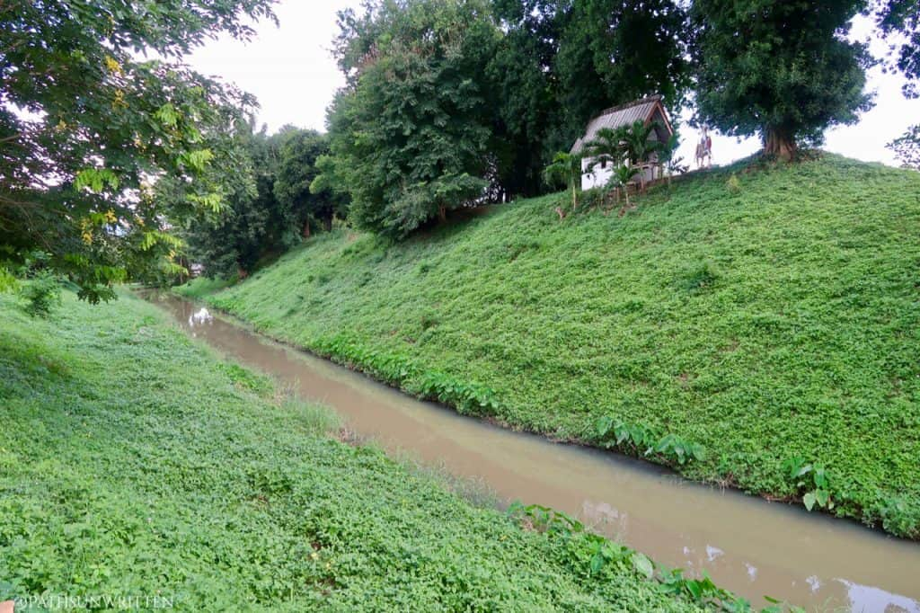 The remnants of the moat continue around the oldest sections of the city wall to the southwest of Pratu Ma.