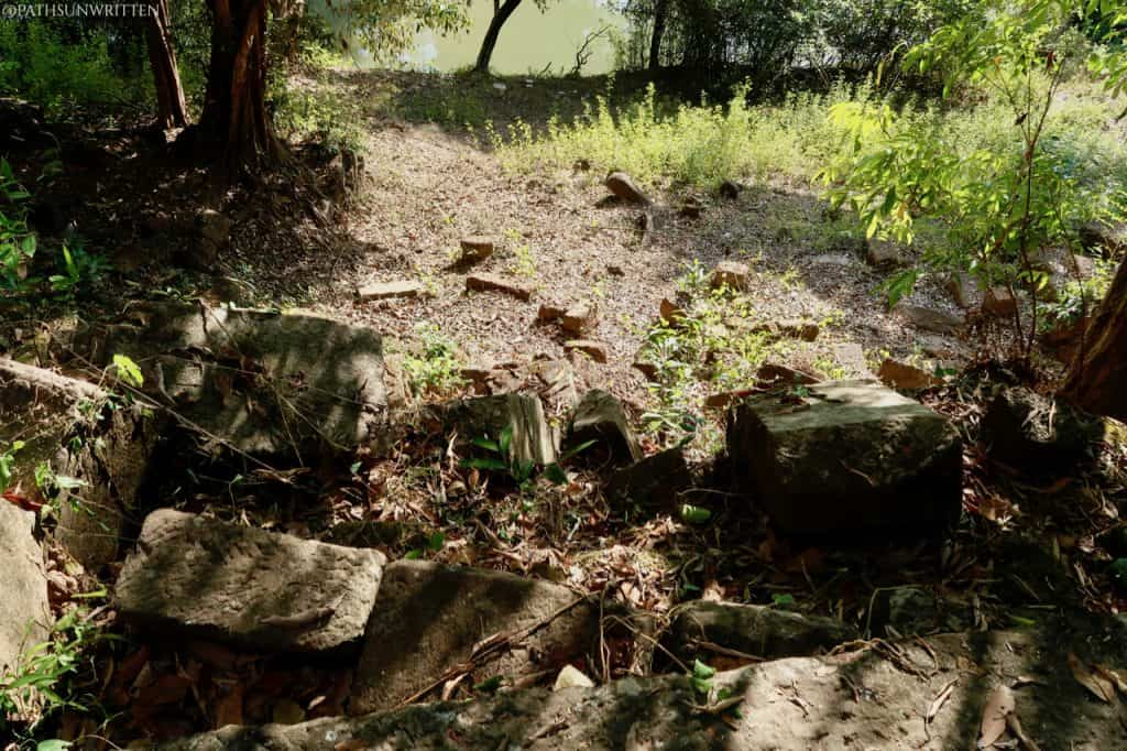 The collapsed stairway leading to the Huay Tomo River.