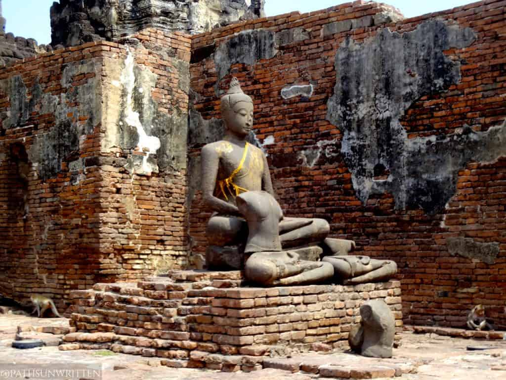 The much younger Buddha in a brick hall . . .