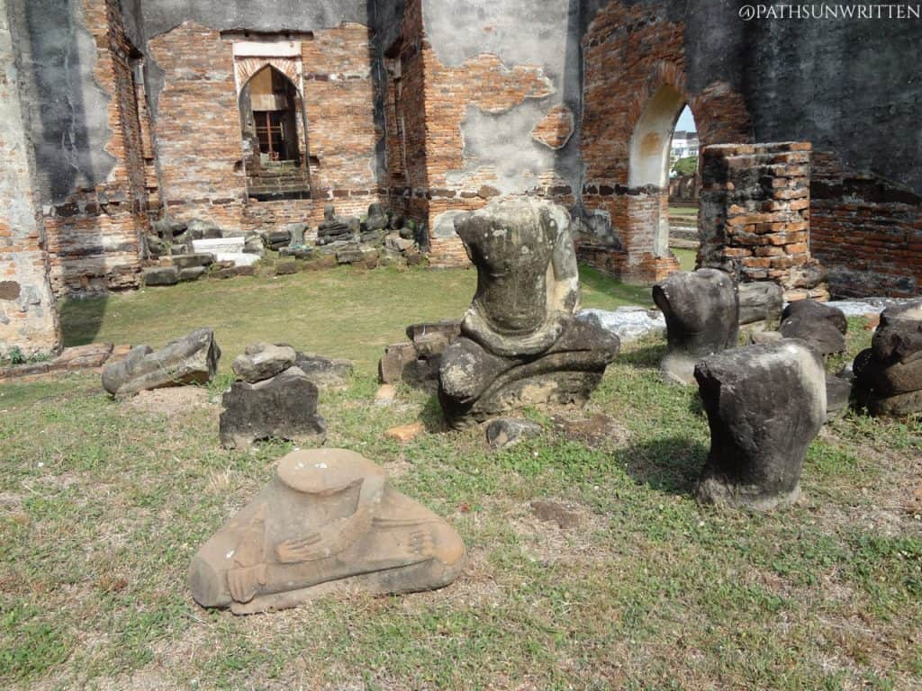 The remains of the Buddha statue inside the wiharn.
