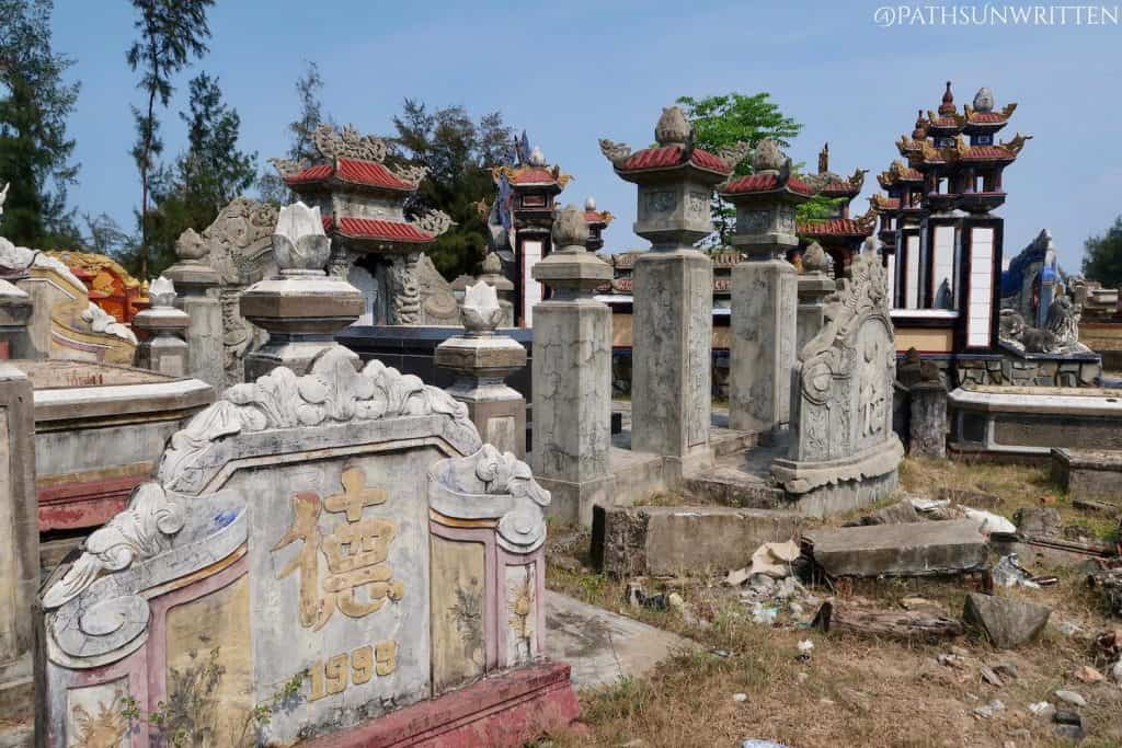 Several kilometers of cemeteries dominate the sand dunes on the way to Tháp Phú Diên