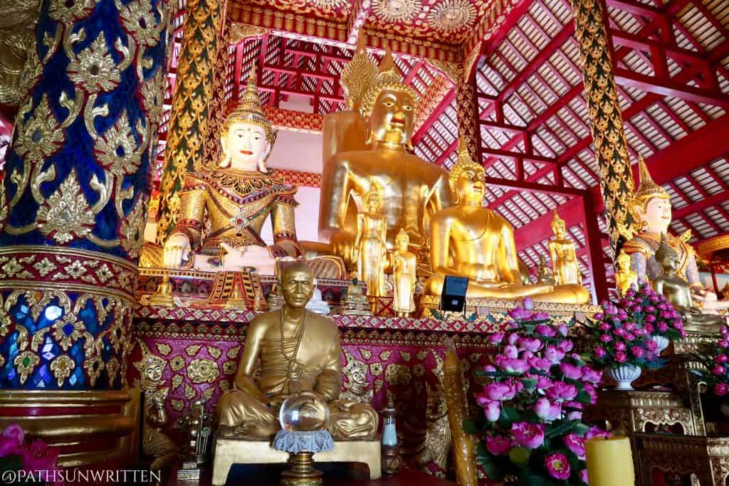 The collection of Buddha statues inside Wat Suan Dok.