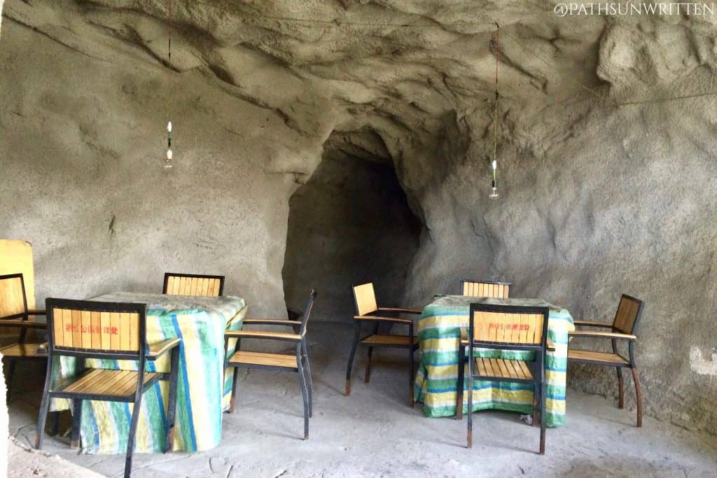 Cave shelter in the mountainside turned into a mahjong parlor.