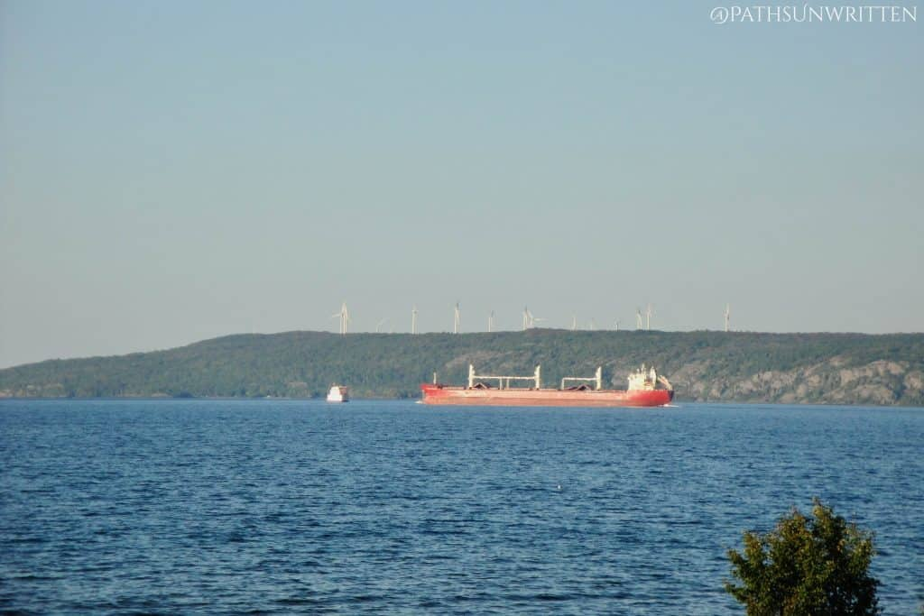 A 'saltie' freighter passes by the narrow channel at Lake Superior's Point Iroquois.