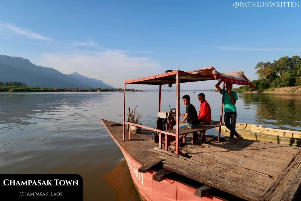 A Mekong River ferry shuttles cars and motorbikes between Champasak's east and west banks.