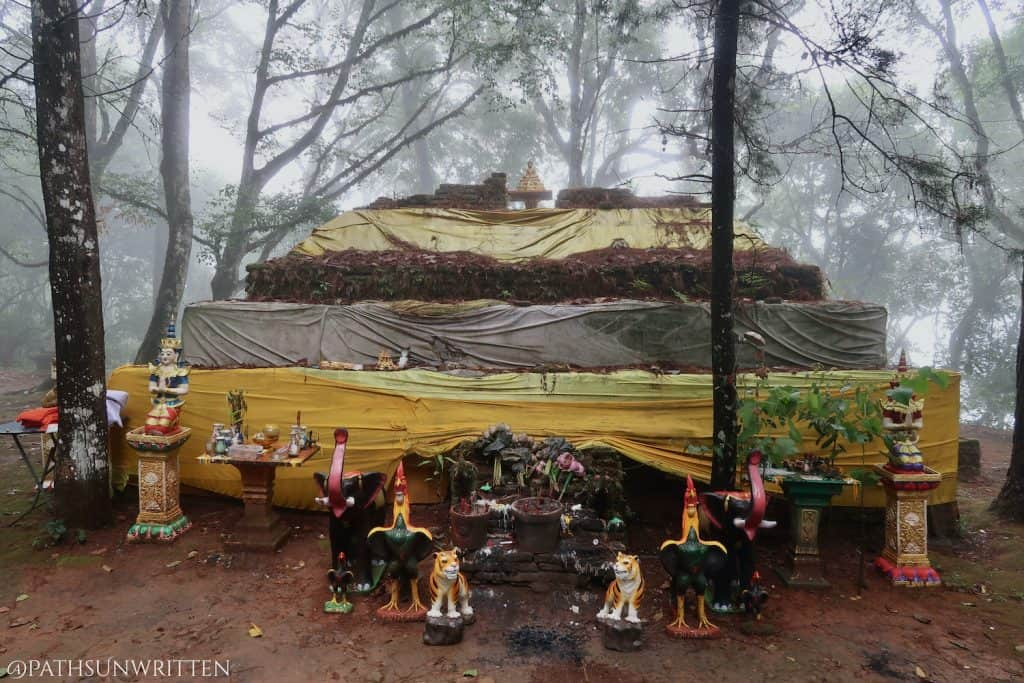 The eastern face of the San Ku stupa with offerings.