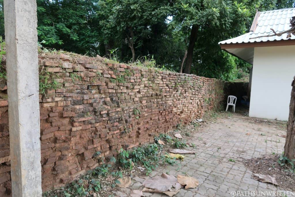 Part of the ancient wall alongside the Wat Pratu Pong temple.