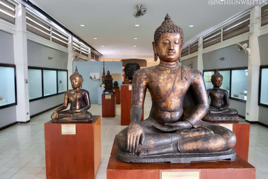 Cast bronze Buddha images from ancient Lamphun on display at the Hariphunchai National Museum.