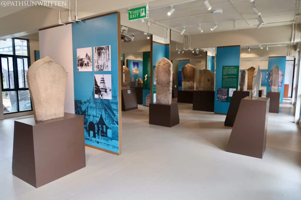 The bottom floor displays inscribed tablets from Lanna and Dvaravati periods.
