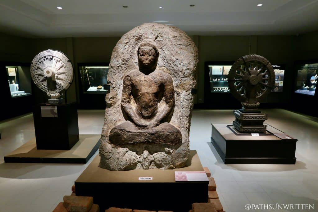 Carved Dvaravati stone images on display at the U Thong National Museum.