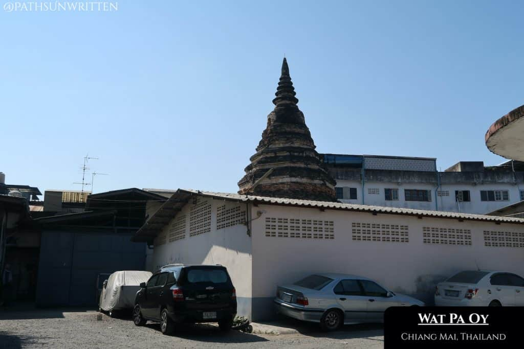 The Wat Pa Oy stupa is surrounded on all sides by buildings.