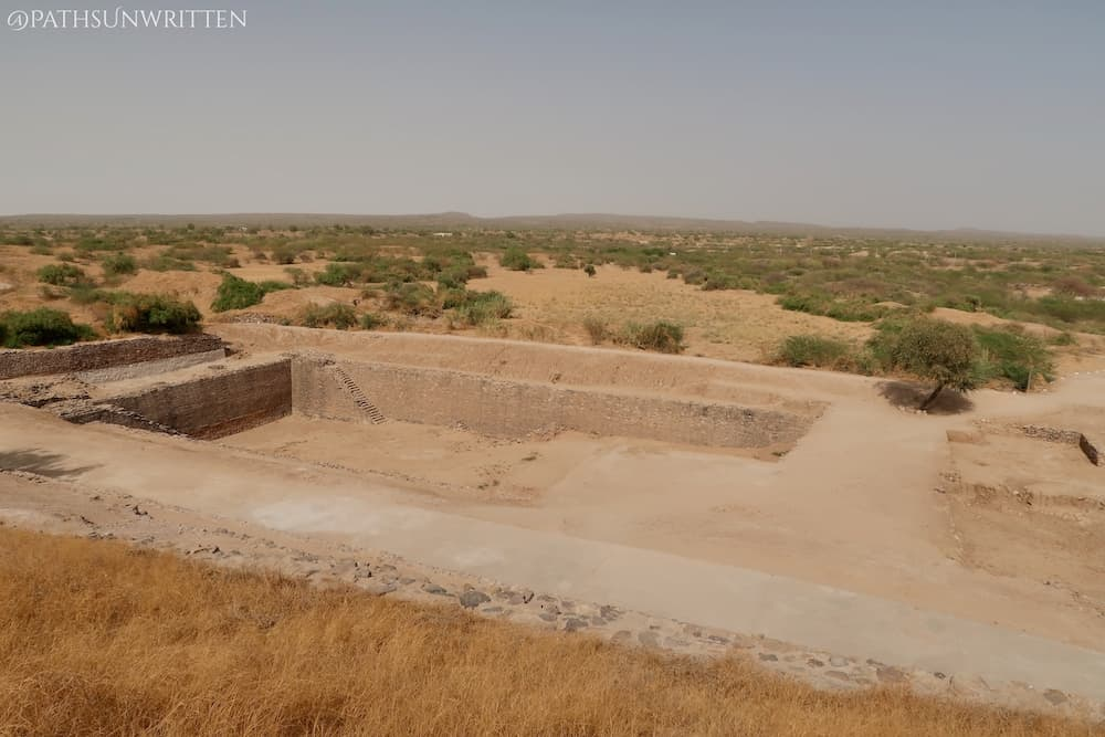 A reservoir in Dholavira with the dried-out Great Rann of Kutch in the background, which used to connect to the ocean