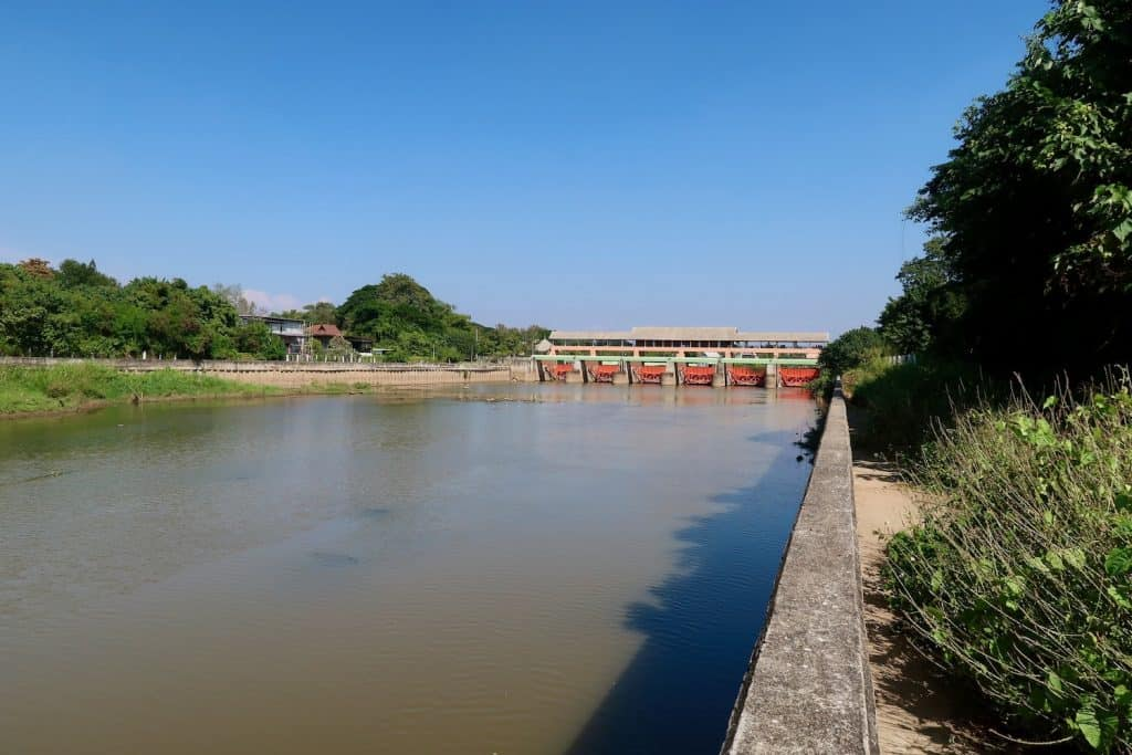 A riverwalk along the modern course of the Ping River near where Wat Patan was once located