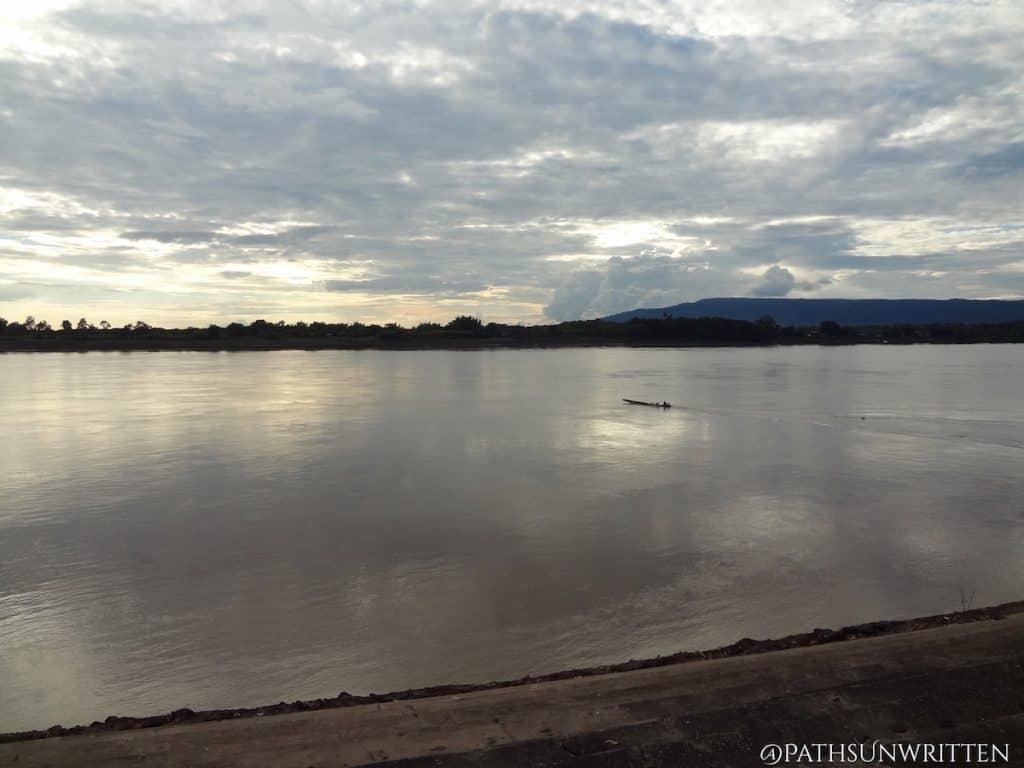 A small boat crossing the Mekong at sunset in Nong Khai Province