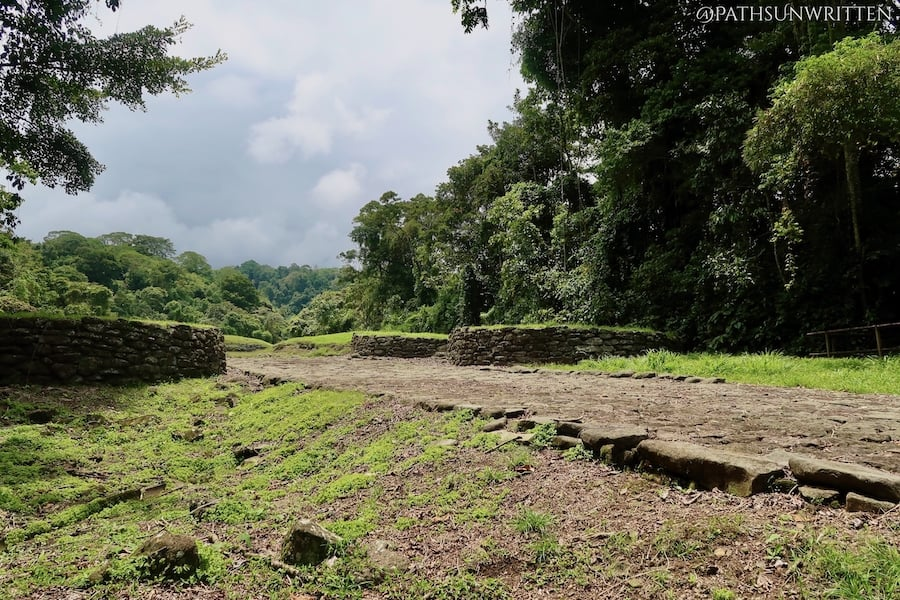 A restored paved road leading into the Guayabo National Monument ceremonial center